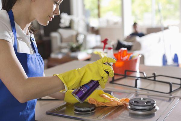 Woman wearing dishwashing gloves during household cleaning