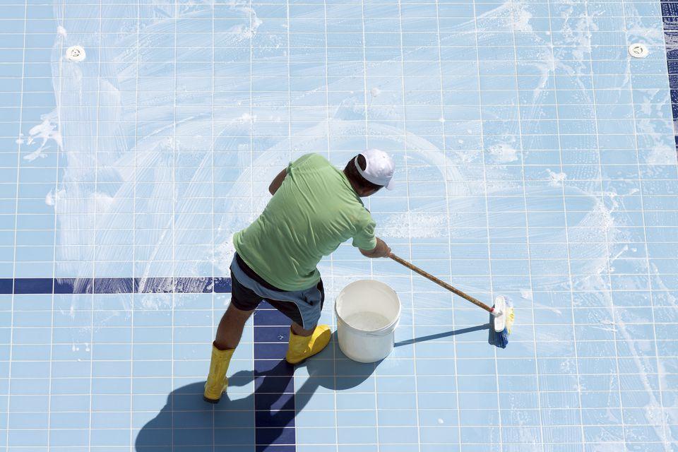 cleaning floor of pool