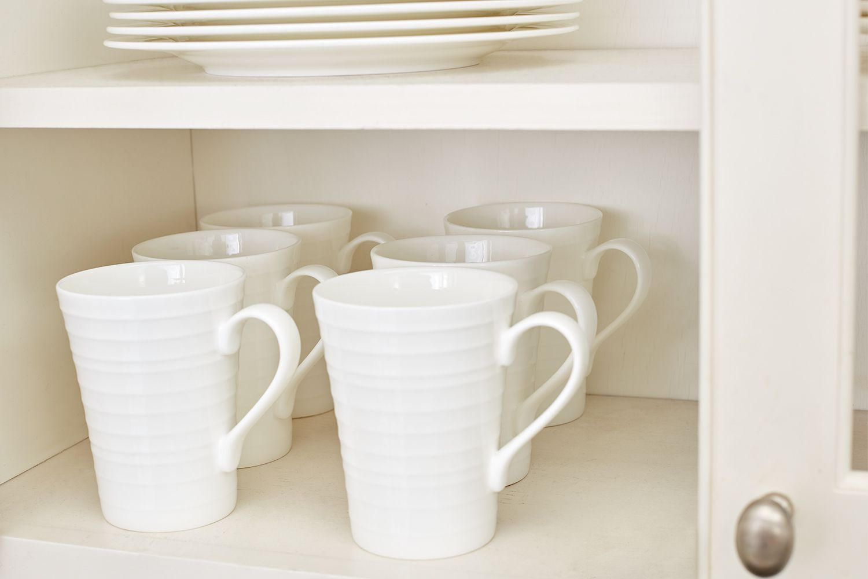 Kitchen mugs in cabinet