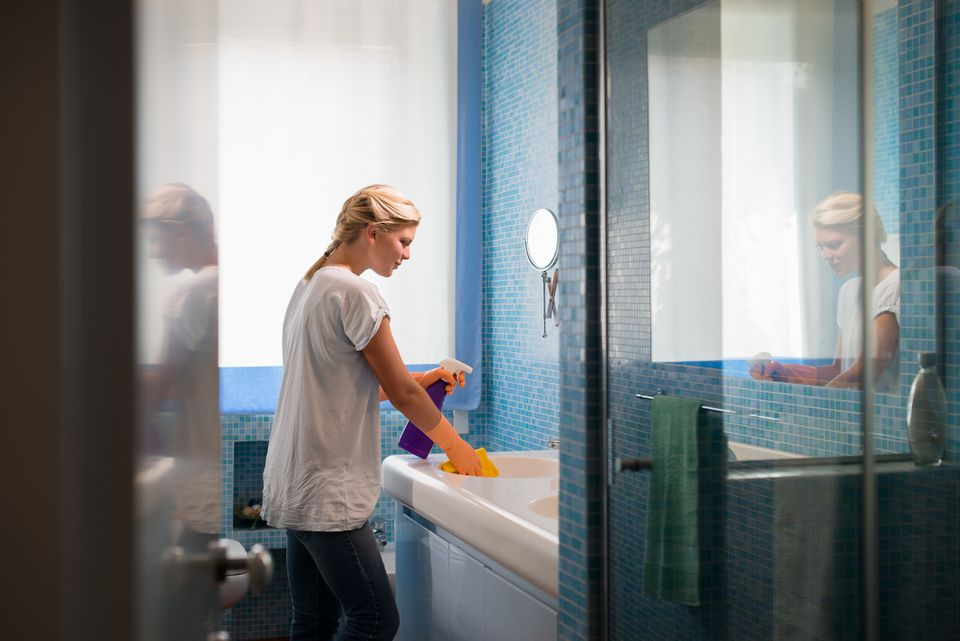 Woman cleaning bathroom