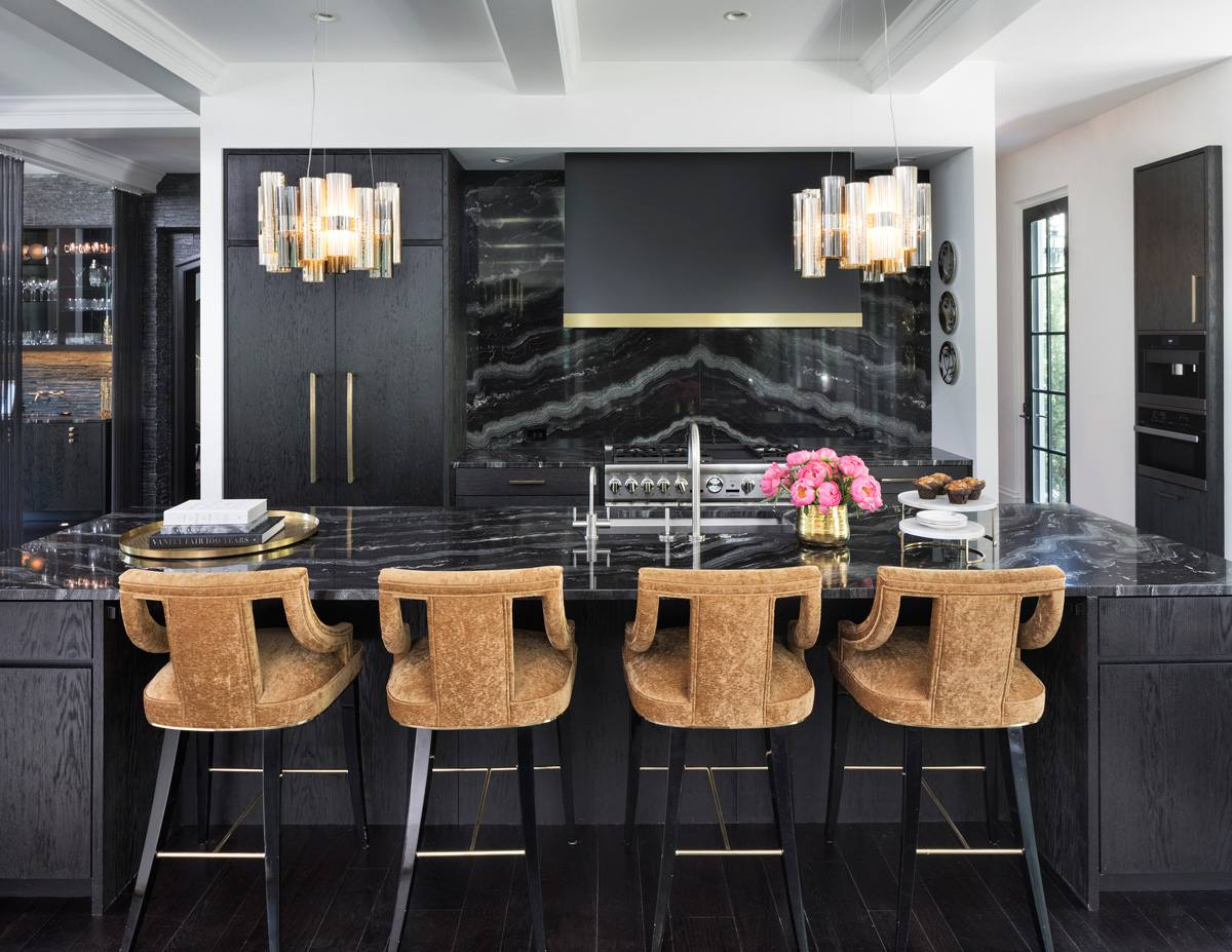 Glam black kitchen with black countertop