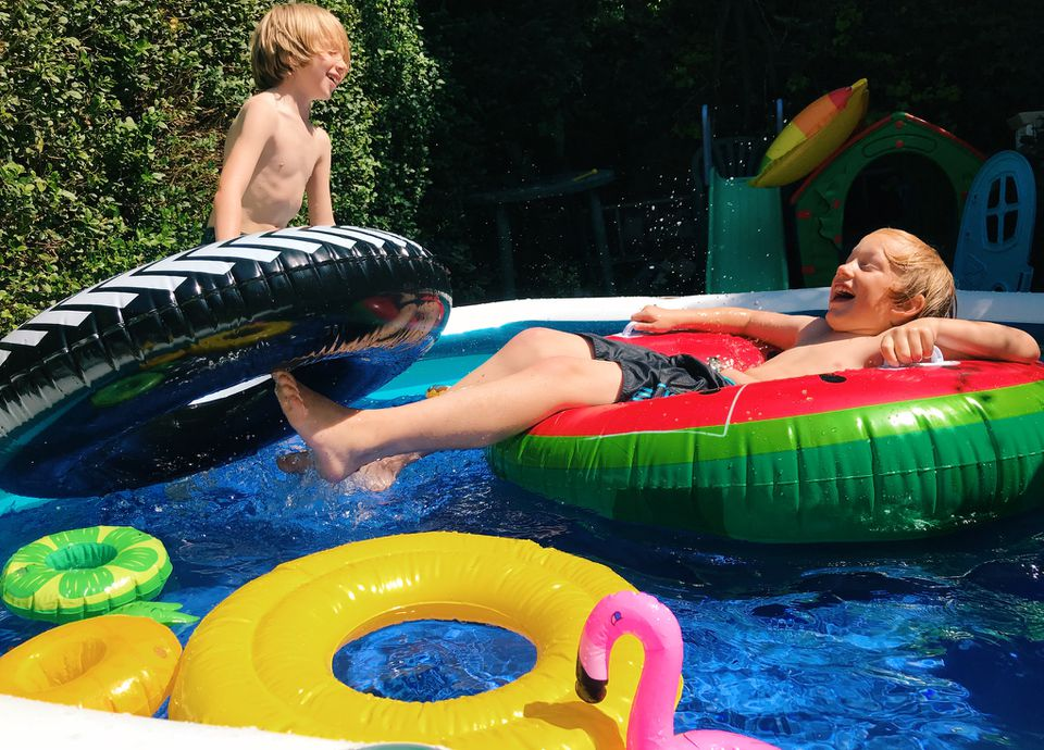 Children having fun playing in a paddling pool