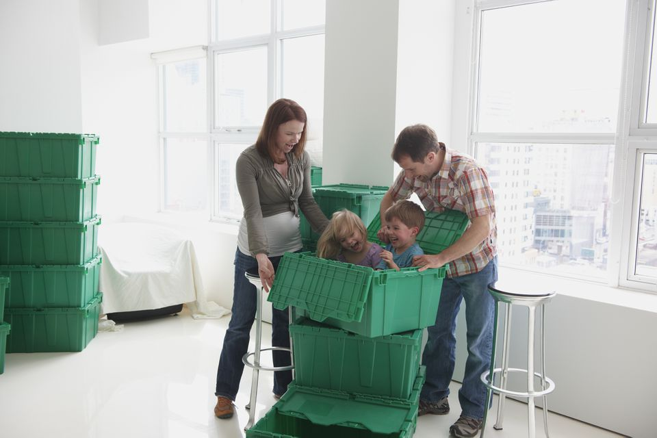 Caucasian family playing in container