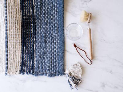 Throw rug with cleaning brush and bowl