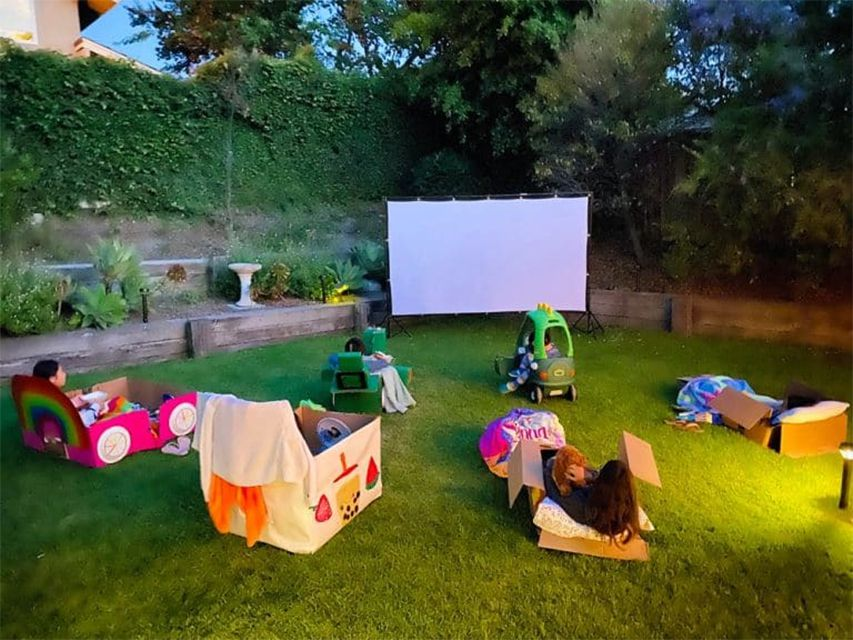 Kids outside watching a movie