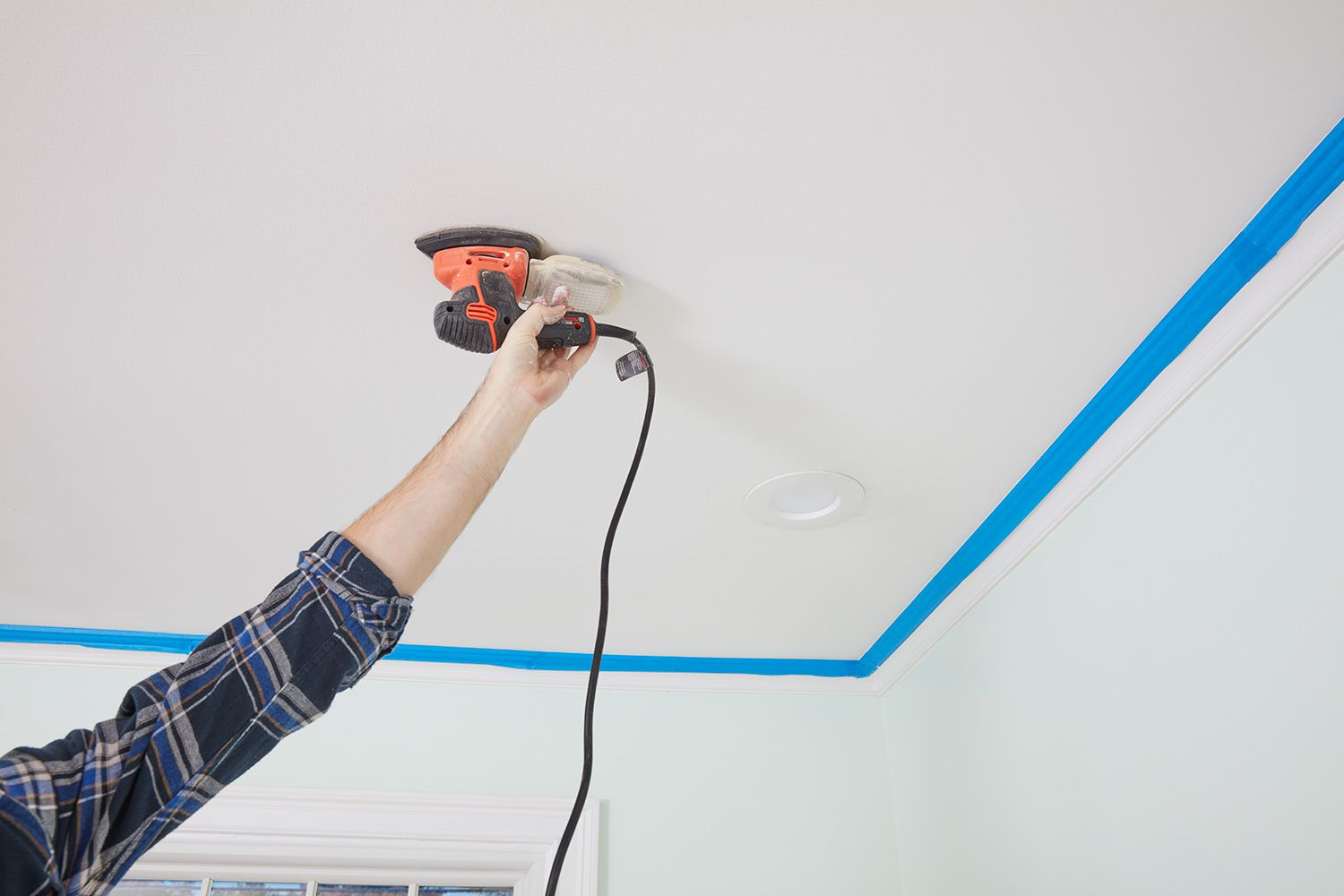 Prep ceiling by sanding any rough spots