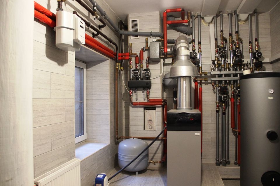 Autonomous heating system in the boiler room. boiler, water heater, expansion tank and other pipes