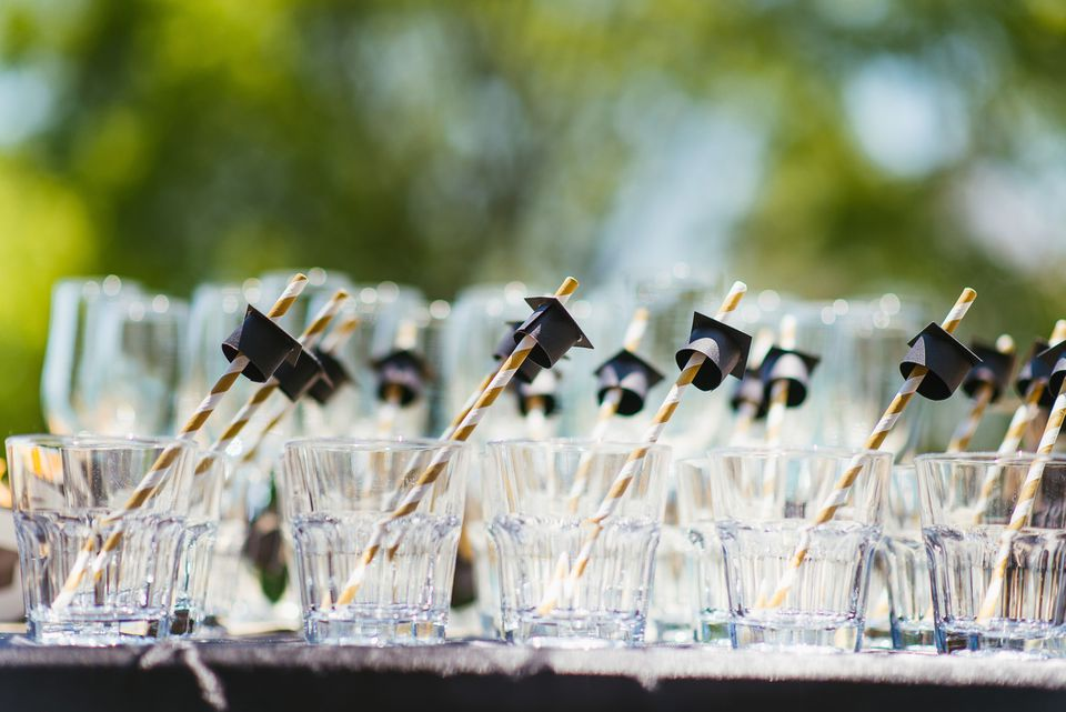 glasses with graduation hat straws