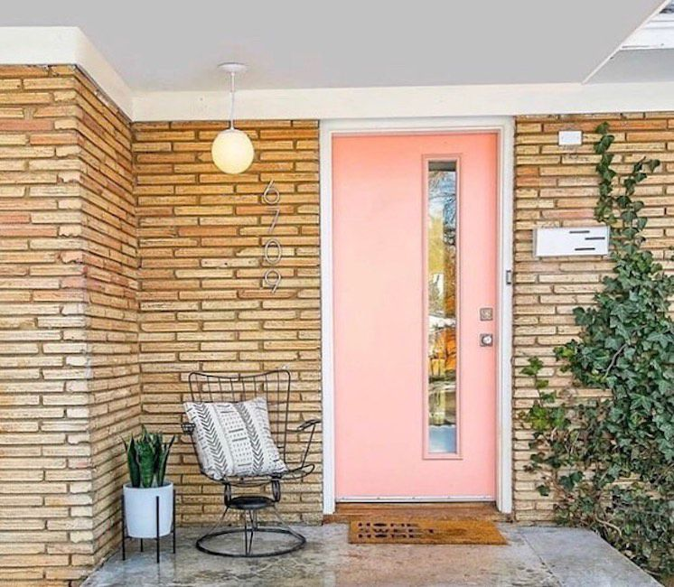 Pink door on brick house