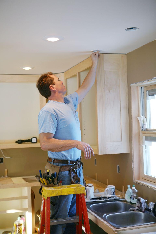 An electrician installing kitchen light
