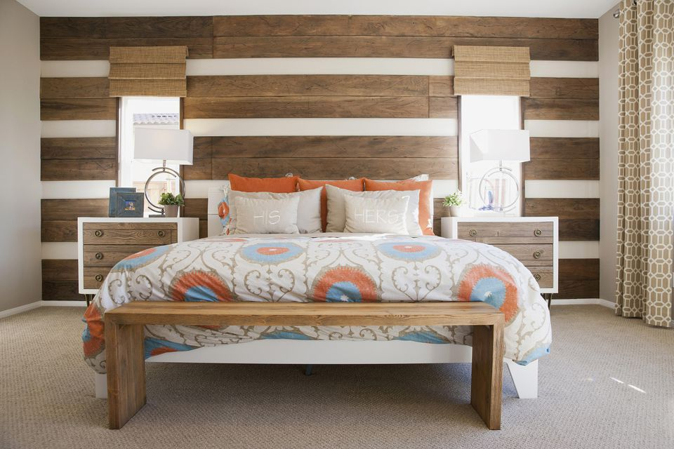 Wood panelled walls in retro orange and blue bedroom.