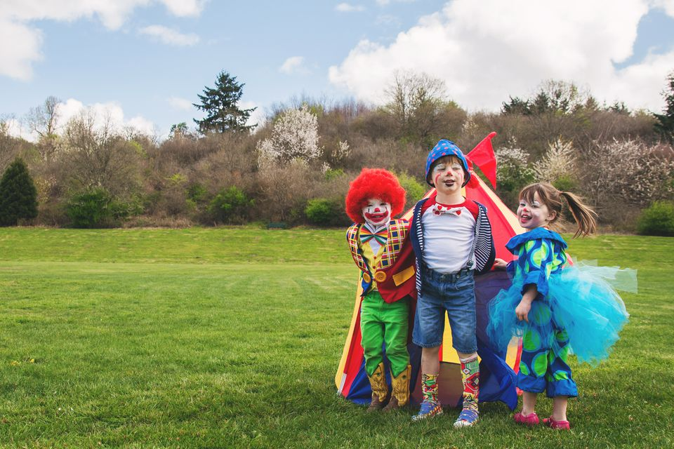 Three children dressed as clowns