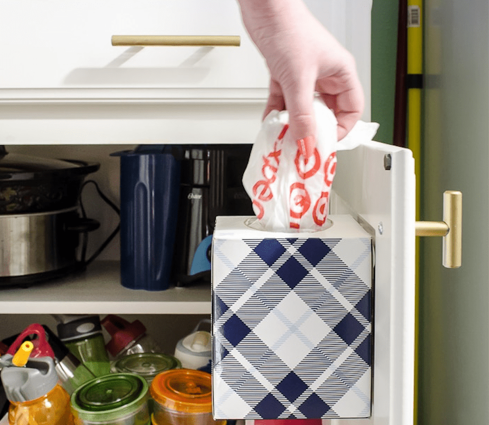 Tissue box holder for grocery bags