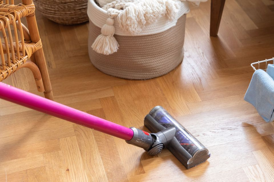 Vacuuming the floor