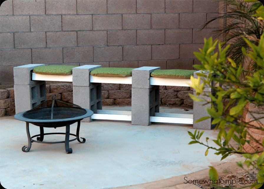 A cinder block bench and a fire pit