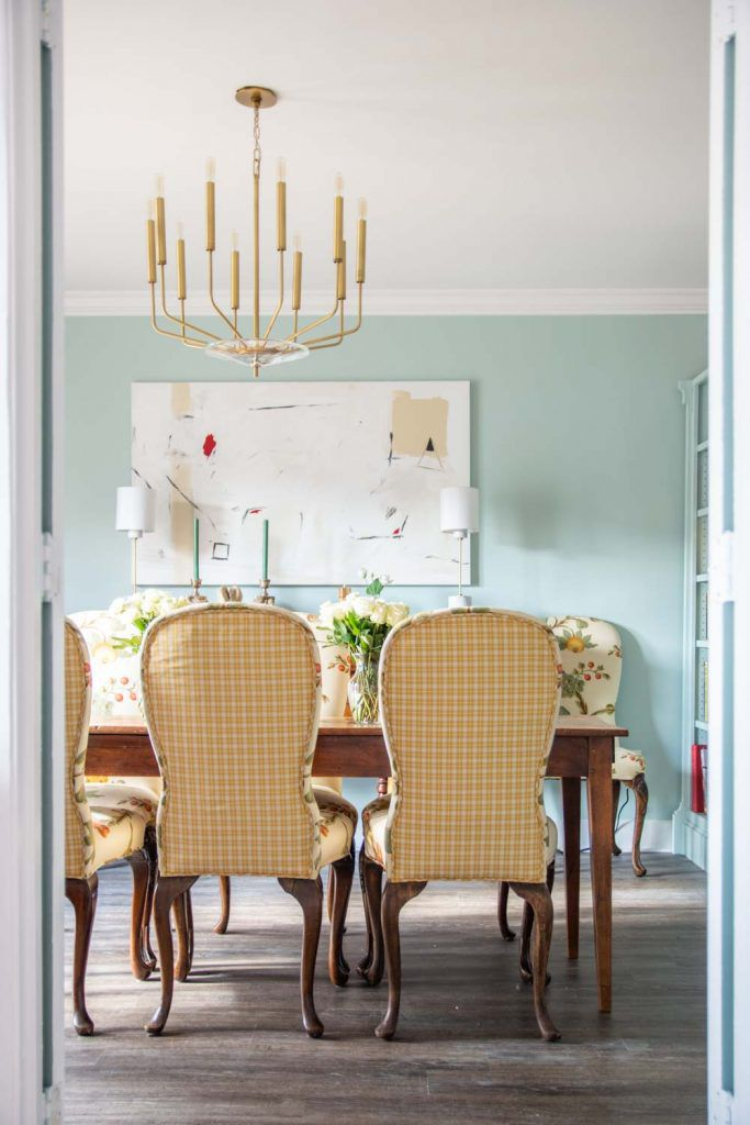 blue dining room with antique pieces