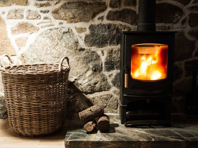 Close-Up Of Wicker Basket By Fireplace