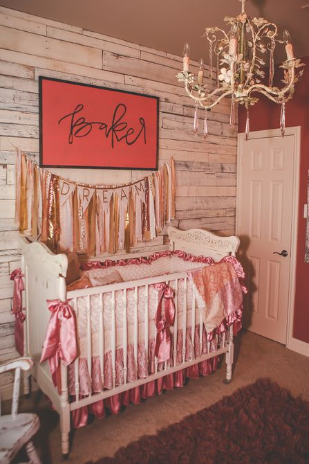 Shabby chic nursery with rustic wooden accent wall