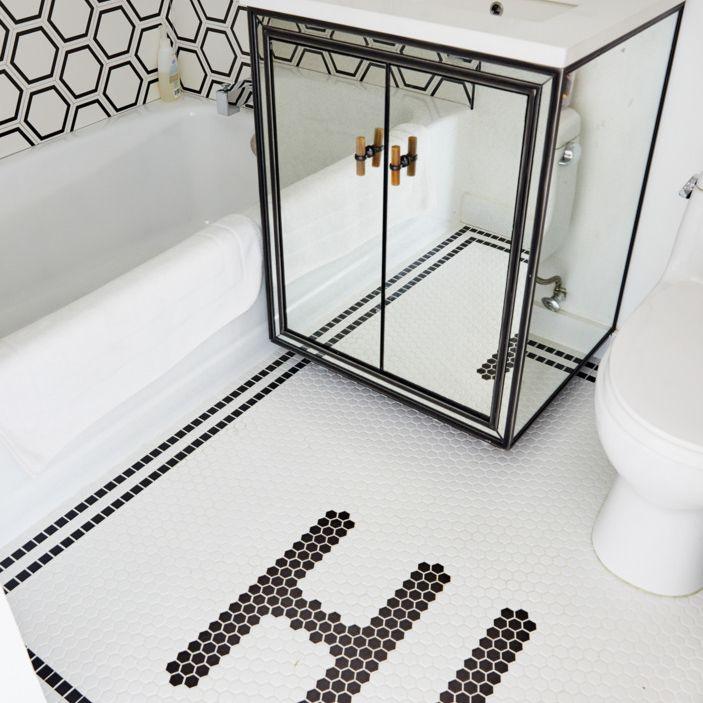Bathroom floor tile that spells Hi