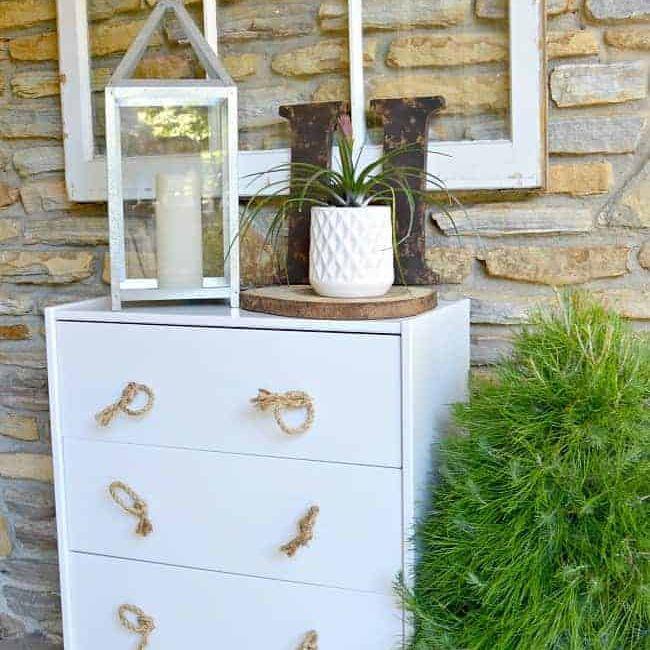 A white IKEA dresser on a porch