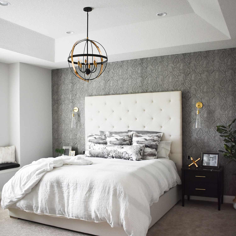 monochromatic gray bedroom with metallic accents