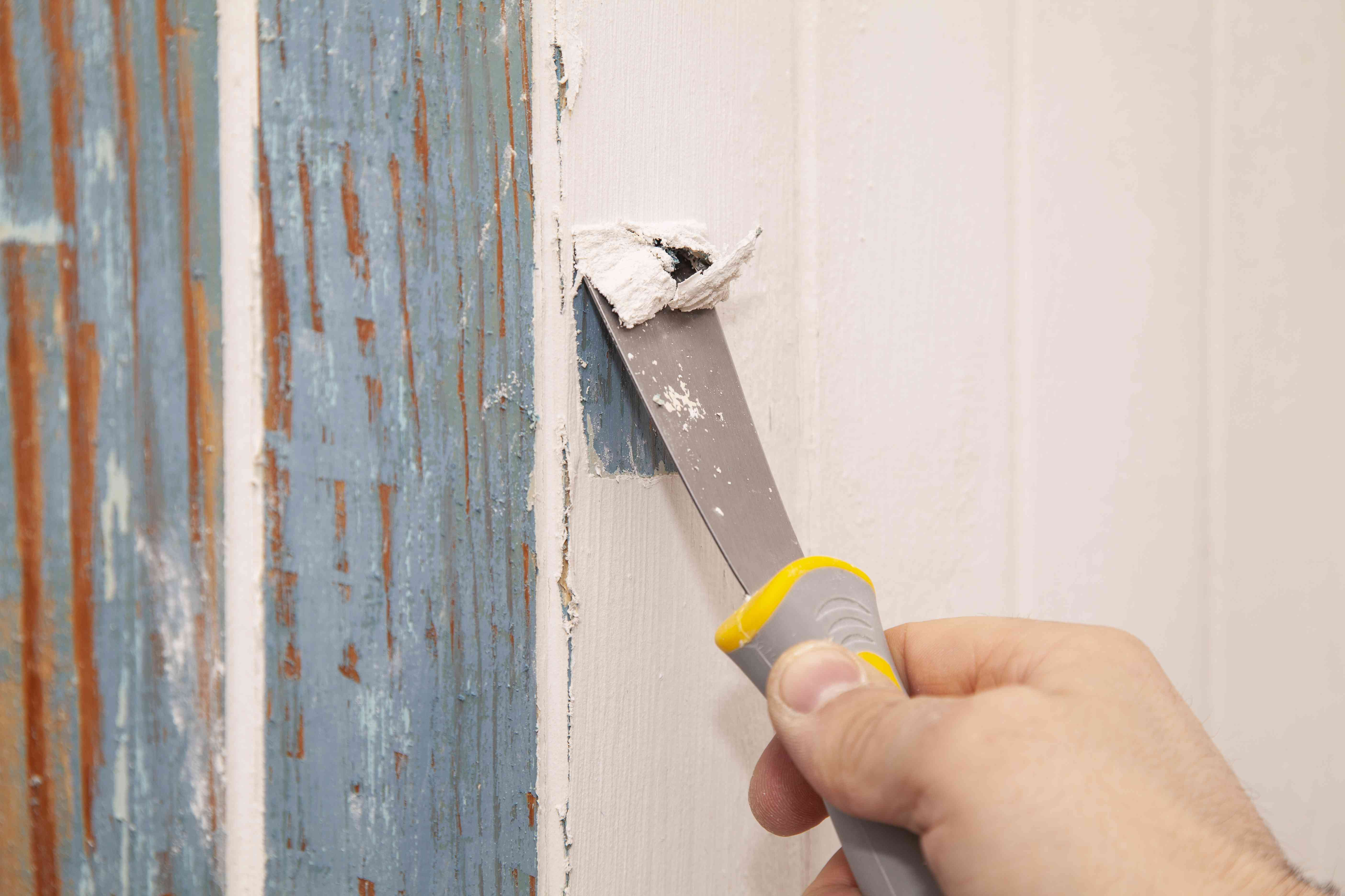 Scraping paint off a wall