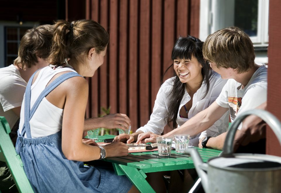 Two girls and two guys playing a game