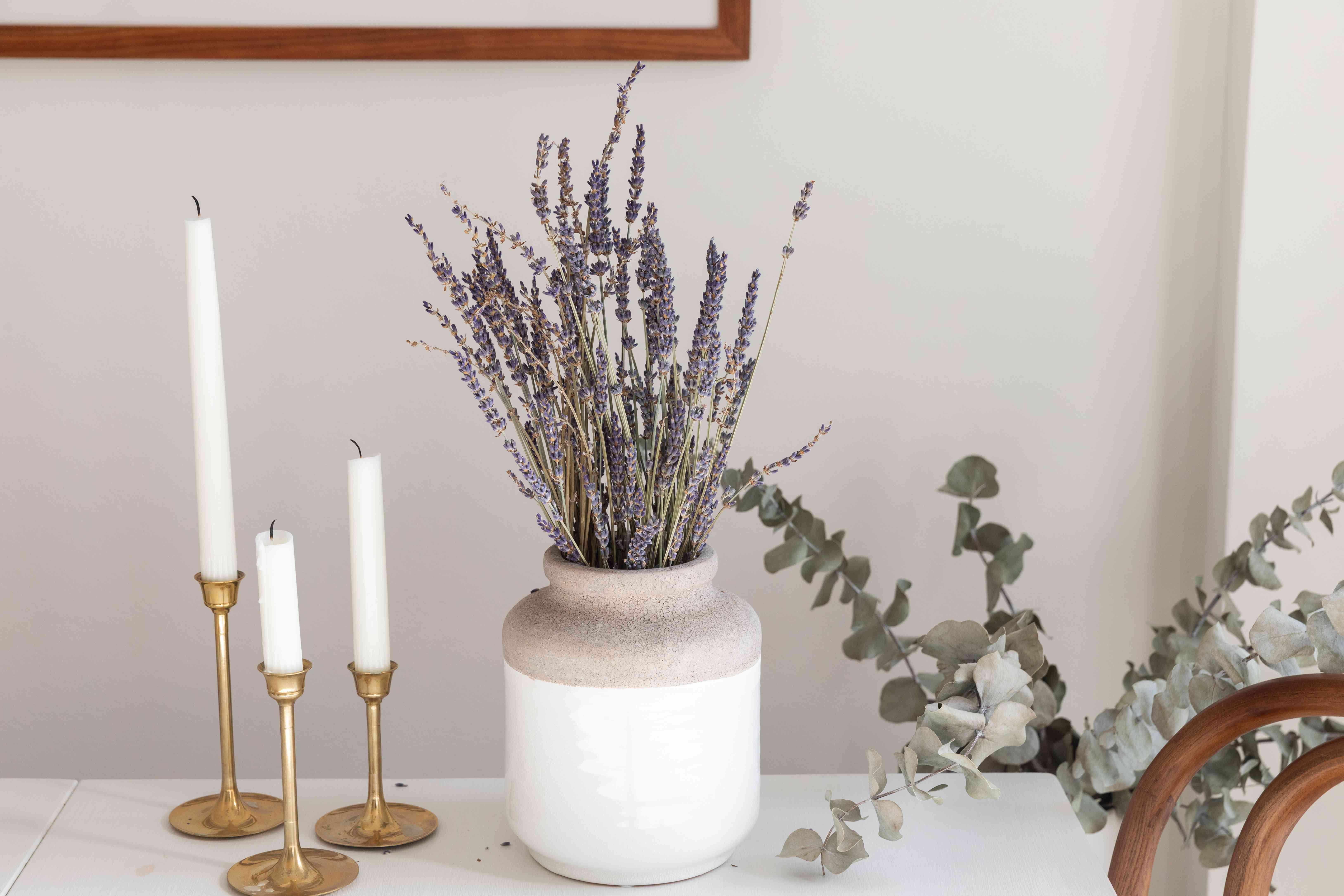 Lavender displayed in white and tan ceramic vase