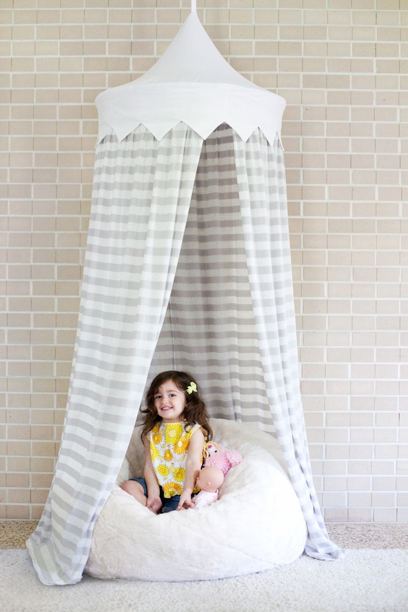 A girl sitting in a tent