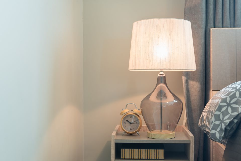 Lamp with lampshade on table