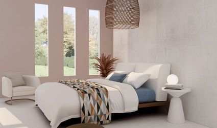 bohemeian bedroom with white walls and earthy colors