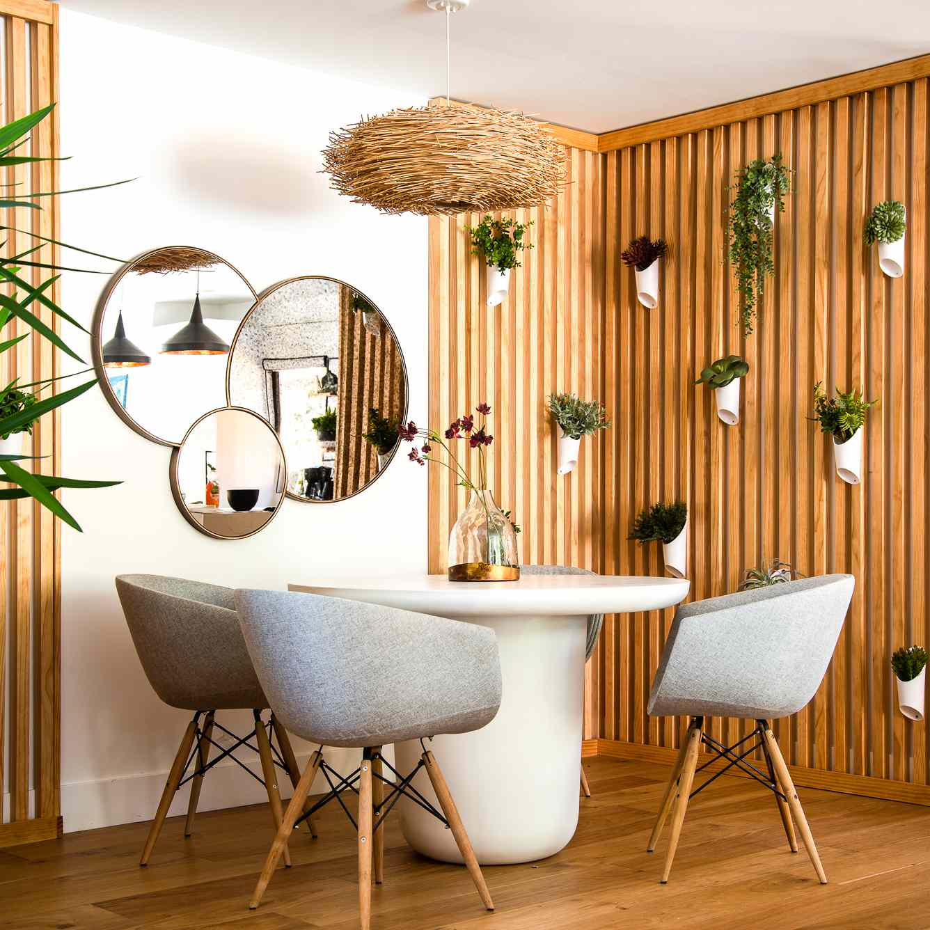 Dining nook with hanging plants and wood panelling