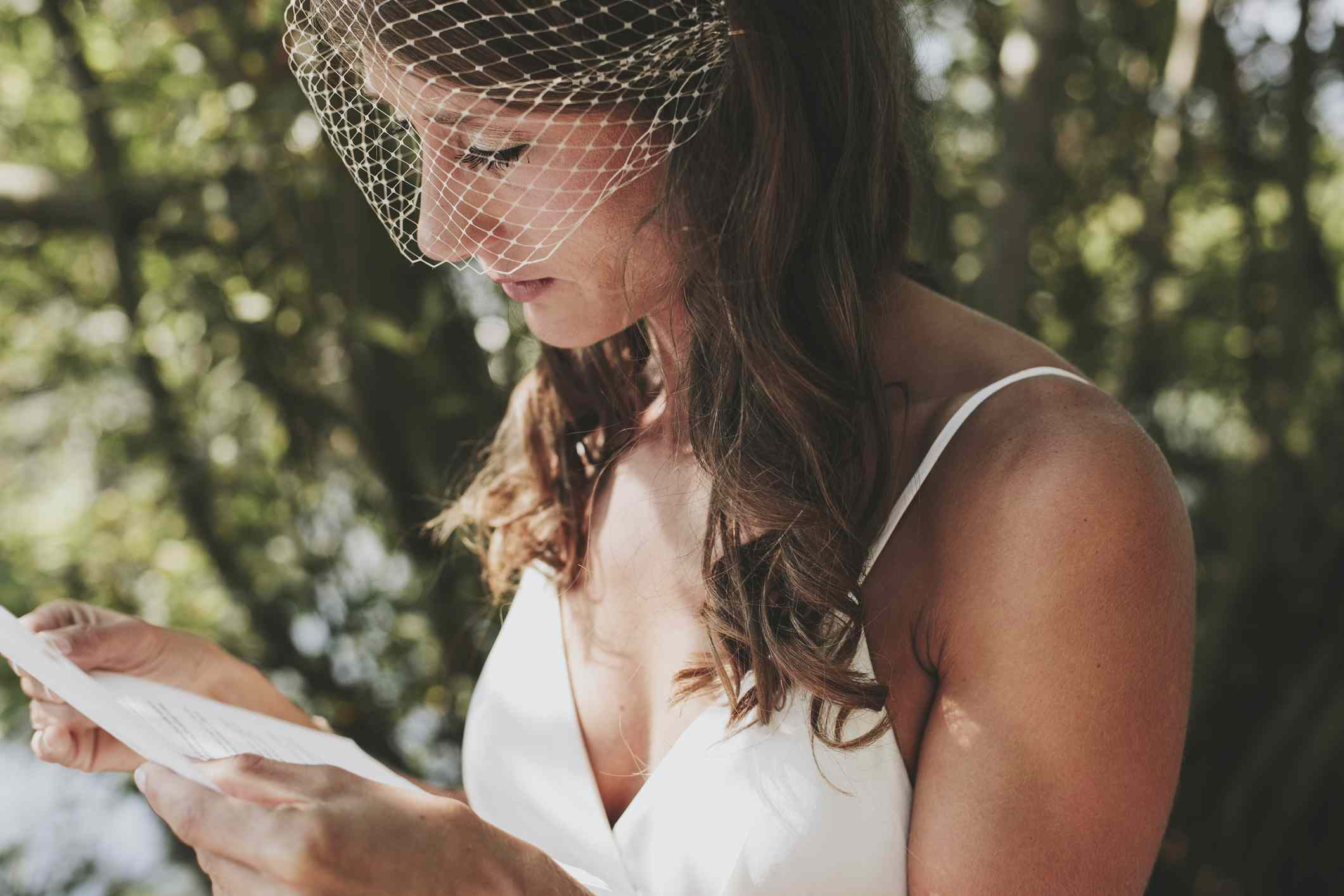 Bride reading from paper