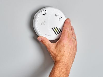 Hardwired smoke detector installed on wall