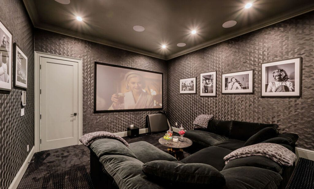 basement with black and white art prints