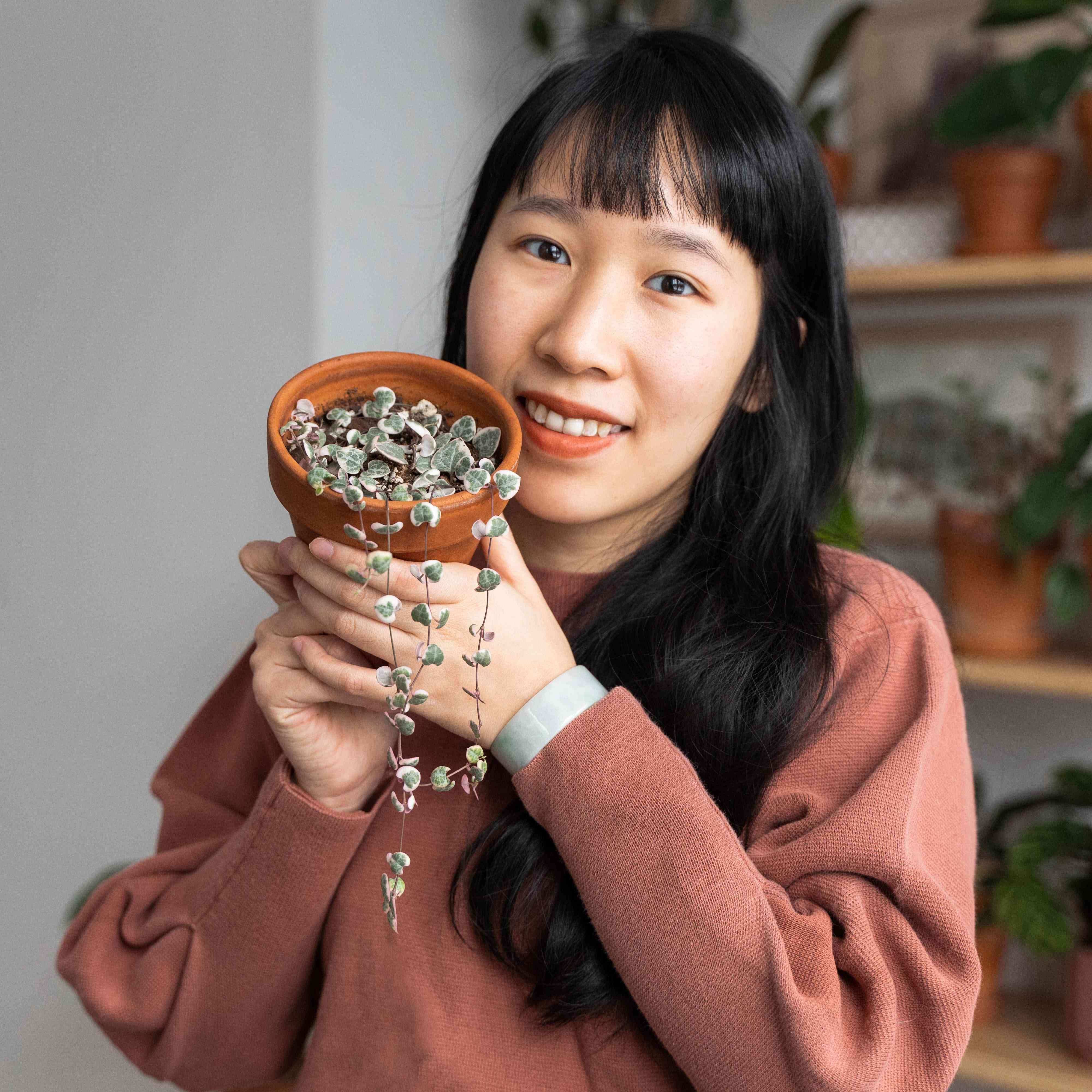 Vionna Wai holding her Variegated String of Hearts