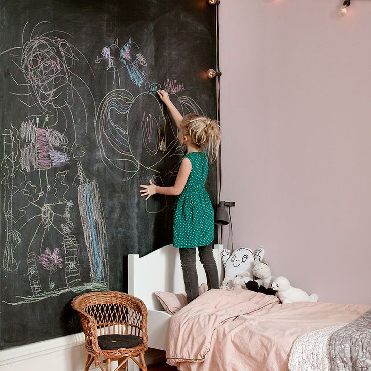 Pink and black girl's room with chalkboard accent wall