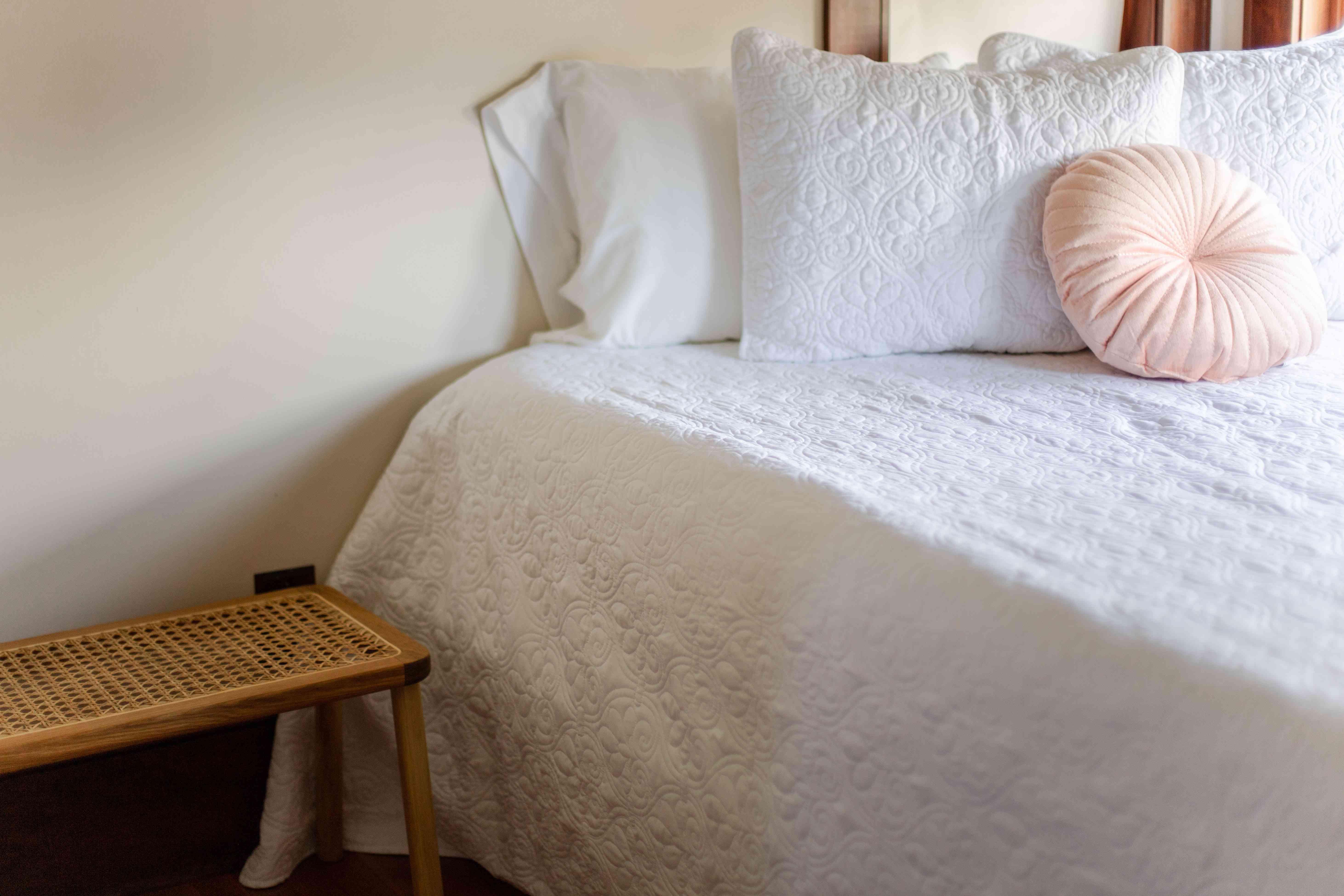 bedspread grazing the floor