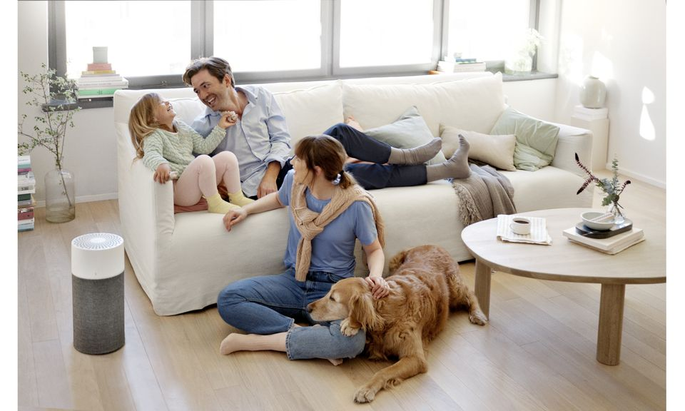 Young family enjoying their living room with the Blueair Auto Filter