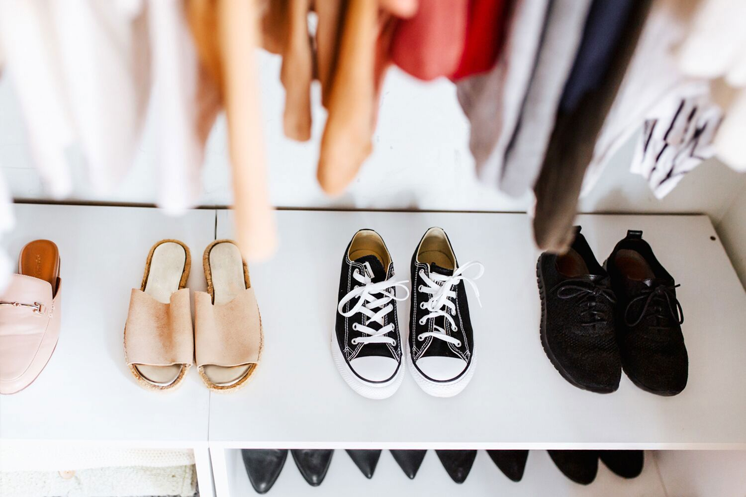 shoes stored in the bottom of a closet
