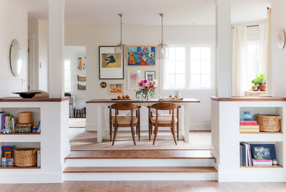 Updated dining room with two stairs leading up to it and colorful, contemporary feel.