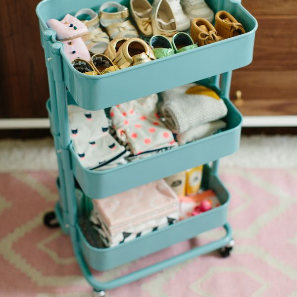 Rolling trolley cart for organizing baby clothes