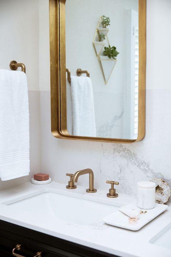 gold fixtures in a bathroom