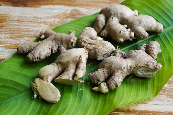 Ginger roots laid next to each on large leaf