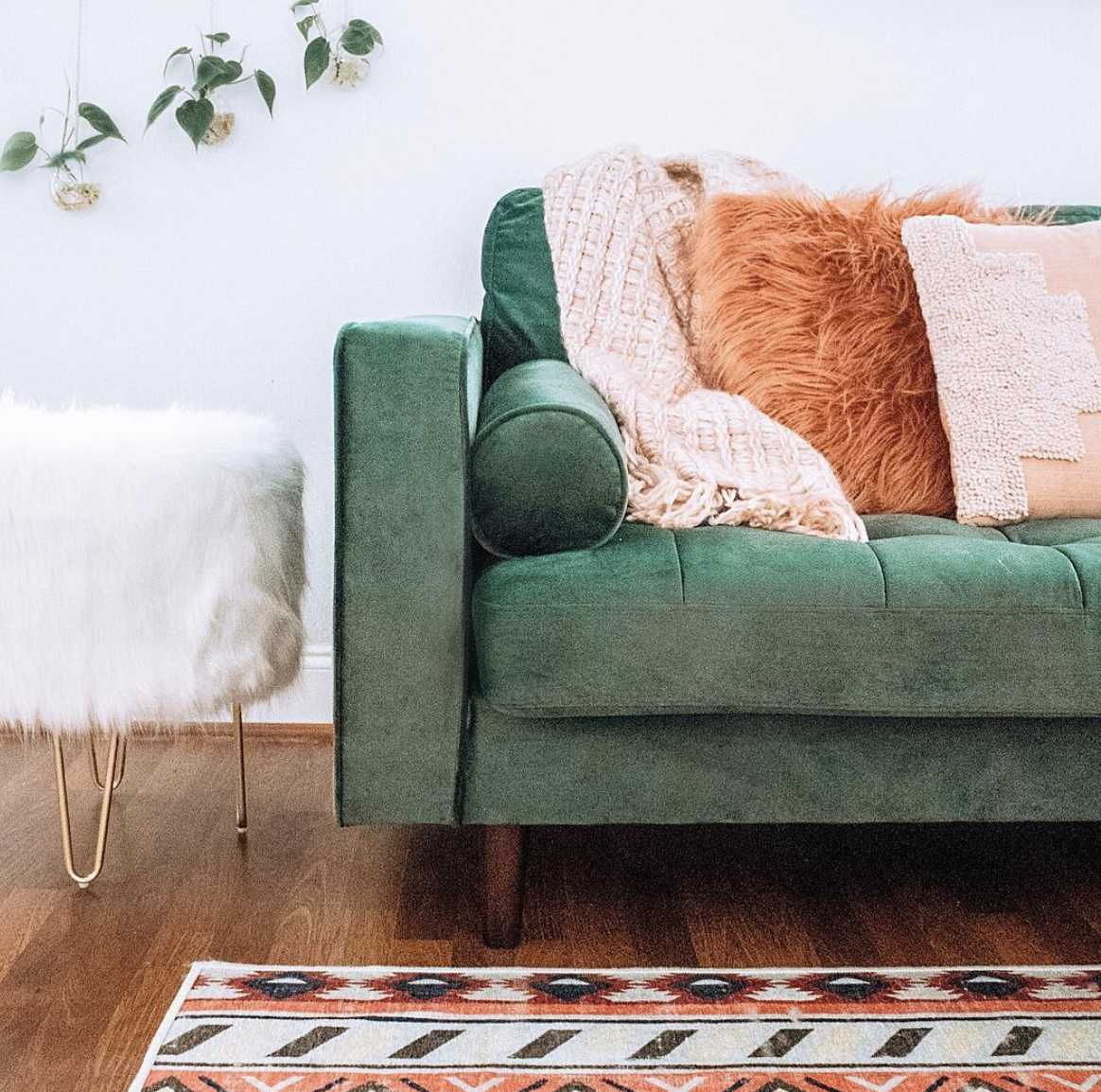 green couch with pillows