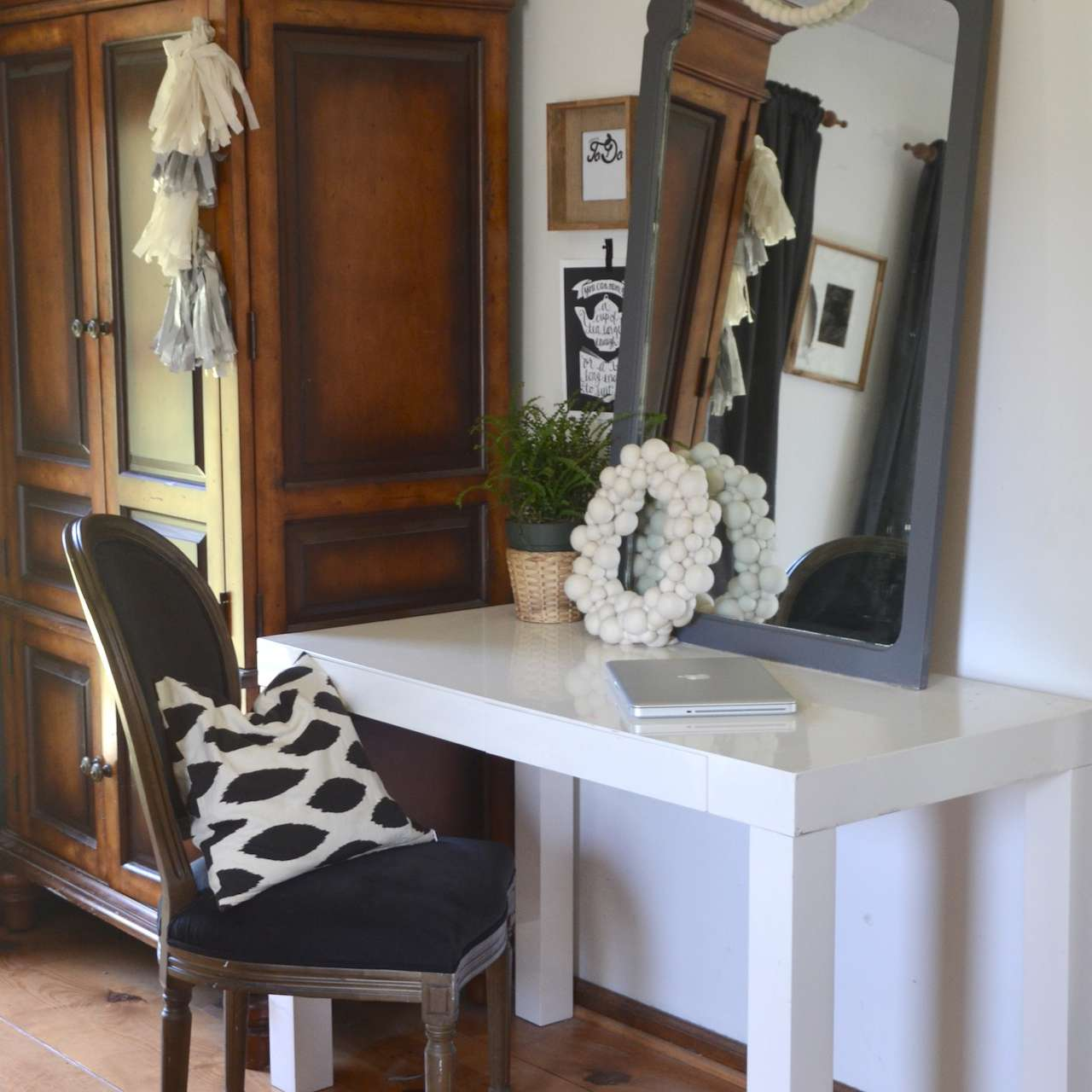 Gray accent mirror on a table