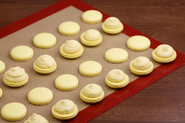 Tan with rust border silicone baking mat with macarons