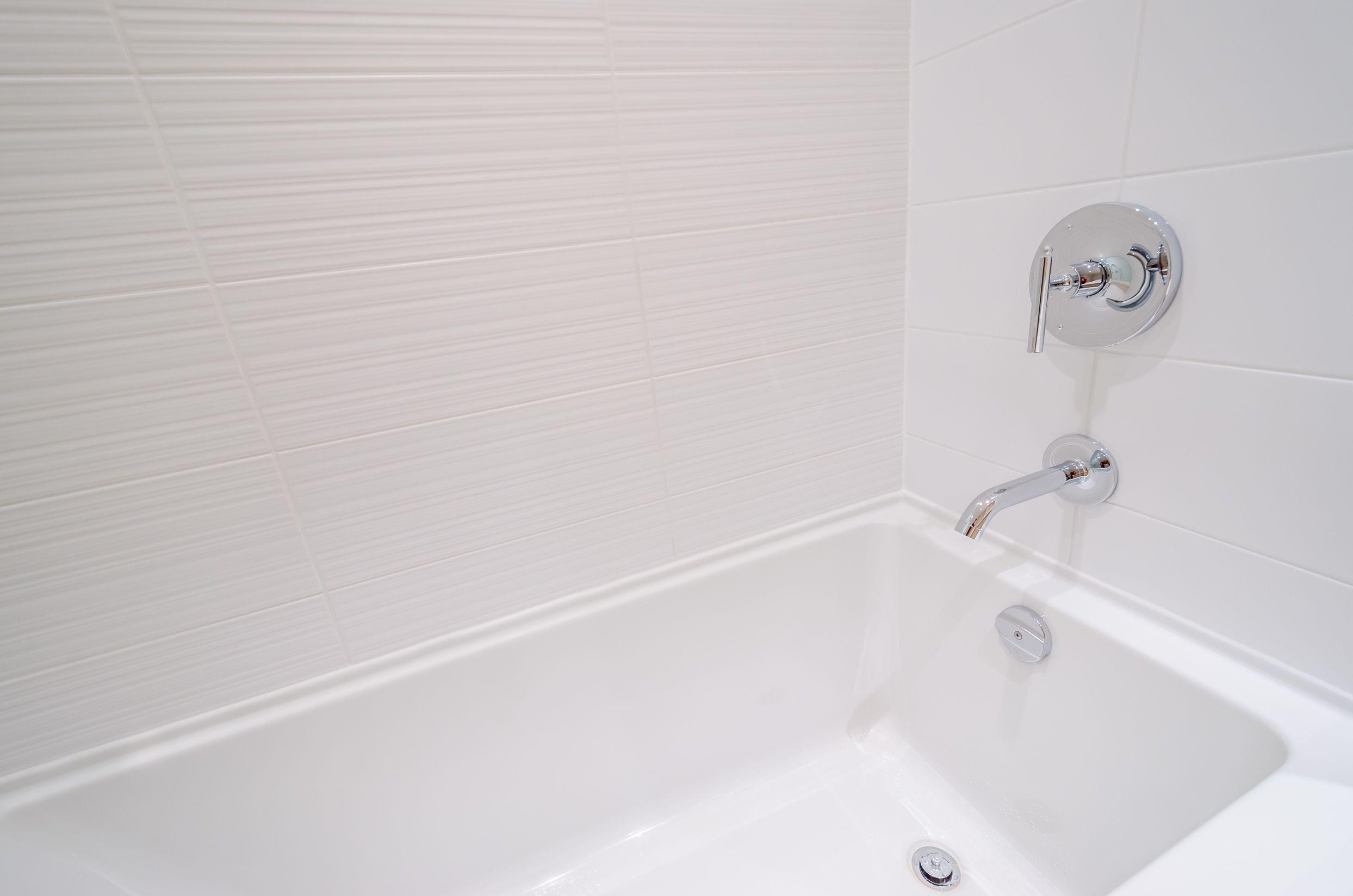 Fragment of a luxury bathroom with a detail of bathtub.