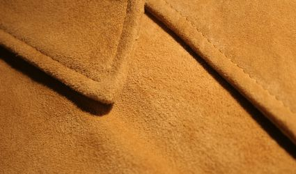 Close-up of camel colored suede jacket