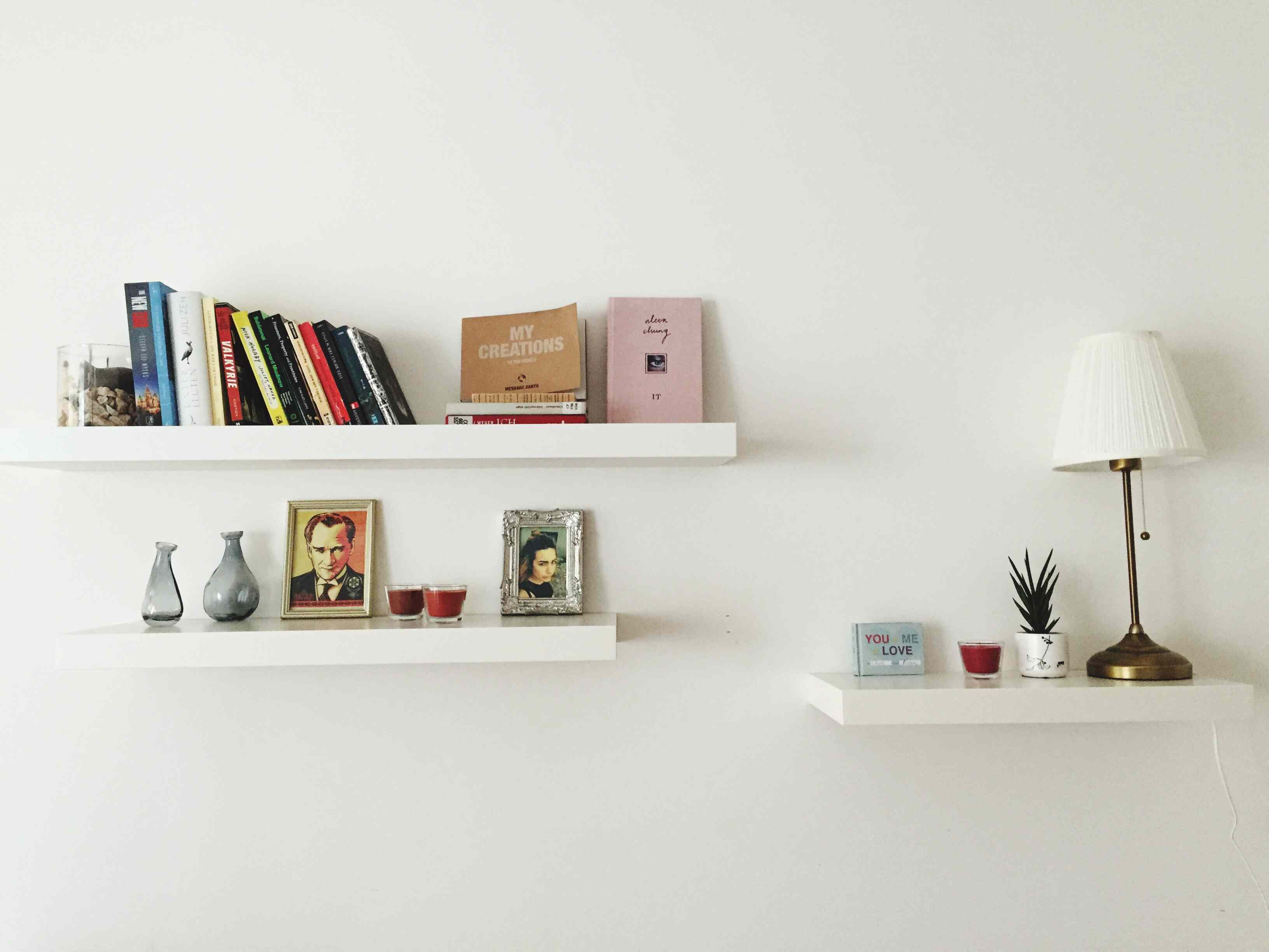 decorated open shelves with books on top shelf